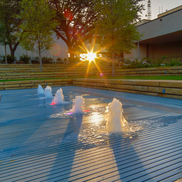 sunset at TI Plaza water feature