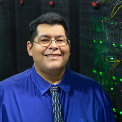 Jerry Perez standing in front of computer hardware